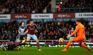 West Ham's Aaron Cresswell scores past Newcastle goalkeeper Robert Elliot in the Premier League